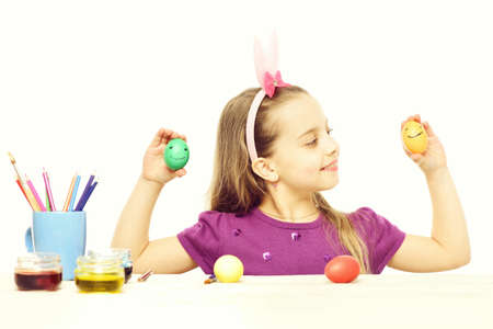 small happy baby girl with easter eggs isolated on white Stock Photo