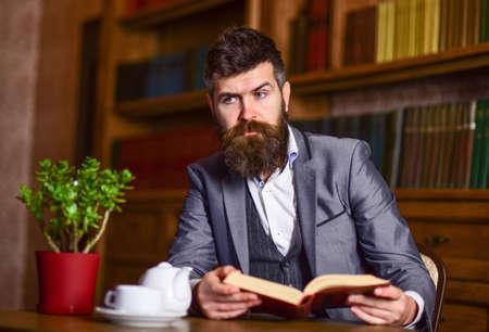 Bearded man in smart suit with teapot. Reklamní fotografie