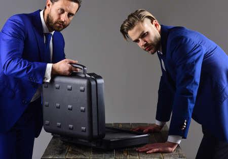 Businessman transfer deal, business black briefcase exchange Stok Fotoğraf