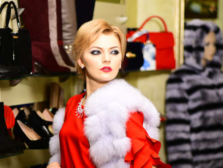 Woman in white mink fur coat shopping with mysterious face