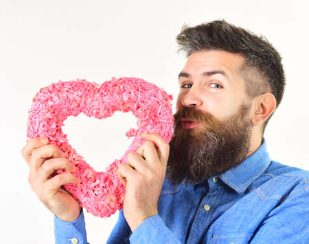 Hipster in fashioned shirt with pink heart.
