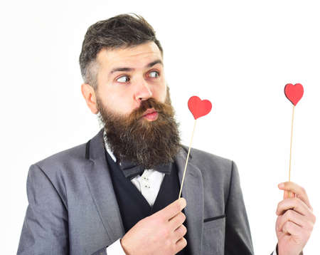 Hipster wears stylish suit and bow-tie. fashion, style, feelings, flirt concept.