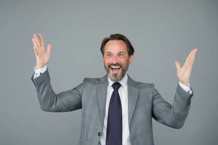 Finally got job. Congratulations. Happy employee make winner gesture. Bearded man celebrate job placement. Celebrate success. Celebrate of contract. Employment and work. Got employed. Lets celebrate