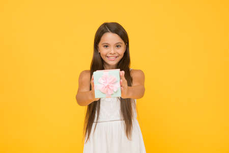 It is for you. little child ready for party celebration. happy childhood. joyful summer holiday. kid with gift box. carefree beauty go shopping on cyber monday. smiling kid share present box Stock Photo