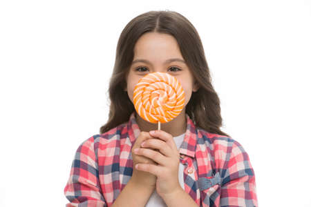 She can not live without sweets. Girl cute smiling face holds sweet lollipop in front of face close up. Sweets in appropriate portions ok. Girl likes sweets lollipop candy isolated white background