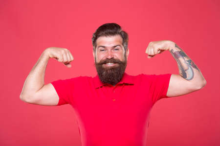 Work at gym. Power and strength. Believe in yourself. Fitness instructor. Who is cool. Strong hipster muscular arms red background. Physical strength. Strong biceps and triceps. Strong muscle workout