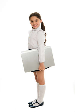 Study digital technologies. Schoolgirl carry laptop for classes isolated white. Child carry laptop for lesson. Digital equipment concept. Education and digital technology. Modern generation knowledge