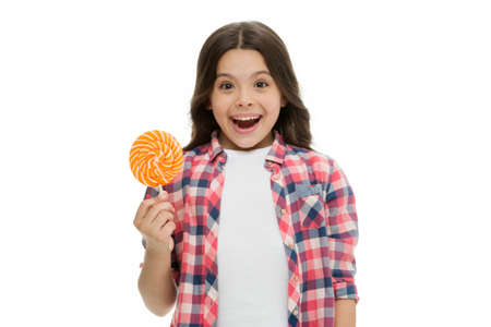 Can sugar make us happy. Girl cute smiling face holds sweet lollipop. Sweets in appropriate portions ok. Girl likes sweets as lollipop candy isolated white background. Control nutrition of your child