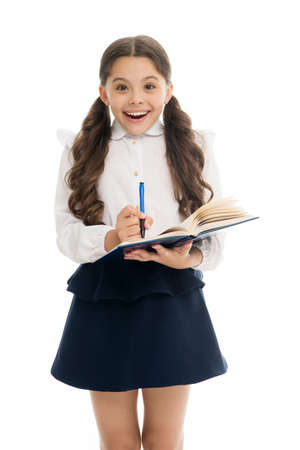 Write note to remember. Child school uniform smart kid happy make note. Child girl happy school uniform clothes holds book and write note. Girl surprised face make note about idea white background