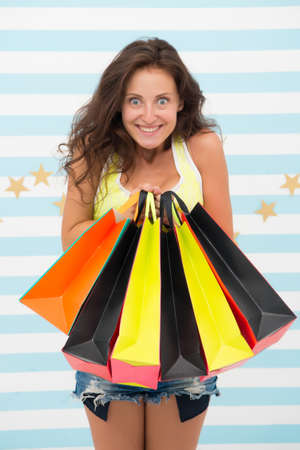 happy shopper girl with shopping bags. happy shopper after day shopping. girl hold colorful sale paperbags. special offer and benefit concept. paper bags in hands of real shopaholic. i love shopping Stok Fotoğraf
