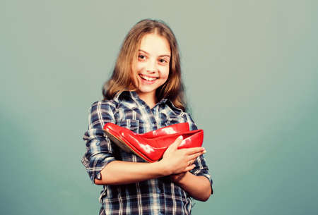 lovely shoes. shoe shop and repair. shoe maker service. happy childhood. small girl with stylish shoes. happy child hold fashionable shoe. high heel lover. shoes shopping. beauty and fashion Archivio Fotografico