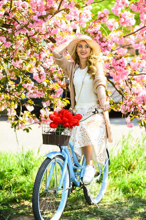 Excursion to park. Bike ride tours. Cherry tree blooming. Woman ride vintage bicycle. Girl and sakura blossom. Spring season. Cycling Tours. Experience culture while having bike ride adventure