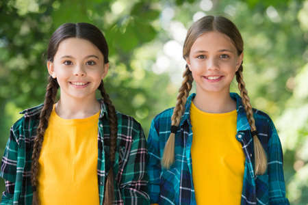 As distinctive as you are. Happy children smile sunny outdoors. Little children enjoy summer holidays. Beauty look of small children. Casual style trend. Happy childhood. International childrens day
