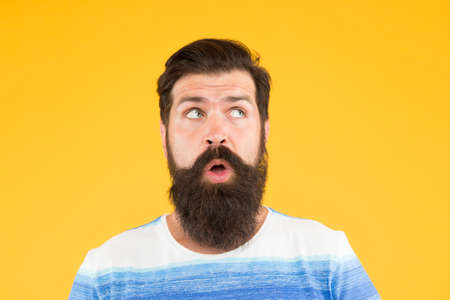 On his mind. Another idea. Have some doubts. Doubtful bearded man on yellow background close up. Doubtful expression. Cunning face. Interesting idea. Guy thinking. Hipster bearded face not sure