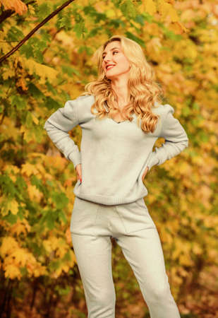 Casually beautiful. Girl relax nature fallen leaves. Clothes for rest. cosy sport suit. Sporty girl. wear comfort clothes. knitwear clothes for fall season. Woman enjoy autumn season in park