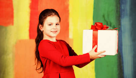 Lets celebrate. small girl carry santa present. big christmas sale. child hold gift box. boxing day concept. all i dream about. happy new year. winter holiday and xmas joy. seasonal shopping discount