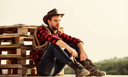 being a Texan. Vintage style man. Wild West retro cowboy. cowboy with lasso rope. Western. wild west rodeo. Thoughtful man in hat relax. western cowboy portrait. man checkered shirt on ranch