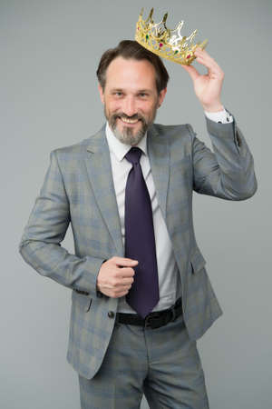 High on confidence. Big boss grey background. Happy man wear luxury crown. Bearded man in formalwear. Selfish and egoistic man. Successful man of business. Extraordinary level of pride