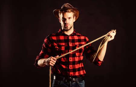 man in hat black background. western cowboy portrait