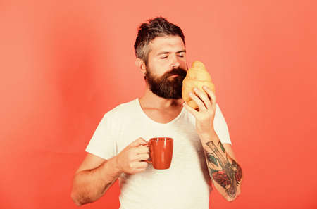 smells good. Fresh baked croissant. Delicious breakfast. Unhealthy but yummy breakfast. Perfect match. feel hunger. Bearded hipster enjoy breakfast drink coffee. Morning tradition concept