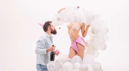 Man bearded bachelor celebrate with strip dancer girl.