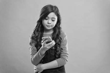 Checking email. Child sms phone. Little girl surfing internet smartphone. Happy childhood. Social networks concept. Exploring internet. Send message. Read news. Incoming information. Internet access