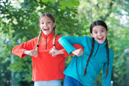 Being as happy as the day is long. Happy children have fun summer outdoors. Enjoying happy childhood. Summer vacation and holidays. International childrens day. Caring positive experience