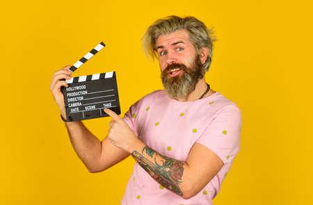 Man holding film clapper.