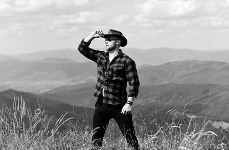 Manly guy enjoy freedom in mountains.