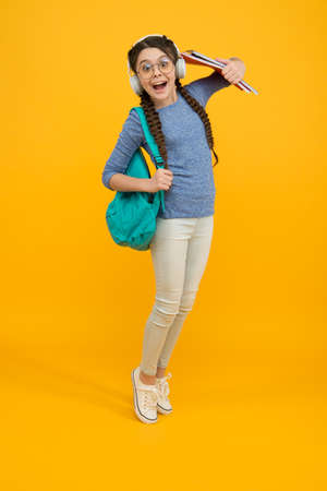 Welcome back to school. Happy child carry backpack yellow background. Little girl back to study. Back to class. School and education. September 1. Knowledge day. Private teaching. Back to school