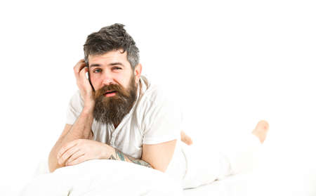 Man with beard and mustache tired, white background. Bad slept