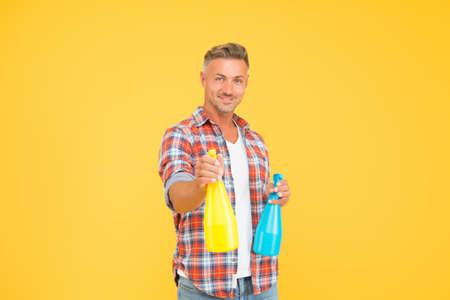 Man spray disinfectant liquid around himself, antibacterial concept Banco de Imagens