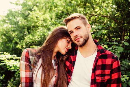 Cute couple. valentines day. summer camping in forest. family weekend. romantic date. hipster couple outdoor. couple in love. Hiking. man and woman in checkered shirt relax in park