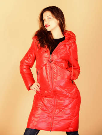 Comfortable down jacket. Red color. Finding right winter jacket is essential to enjoyable and bearable winter season. Shop for quality. Girl enjoy wearing bright jacket. Warm coat. Fashion model