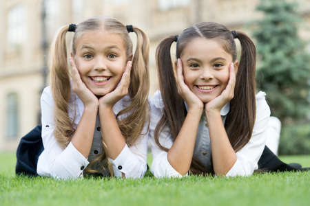Smile and go back to school. Happy children smile on green grass. Dental hygiene. Tooth health. Pediatric dentistry. Oral medicine. All it takes is cute little smile