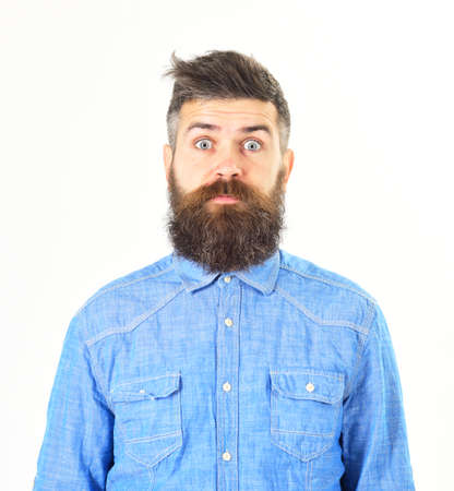 Man with surprised face wears denim shirt, isolated white background
