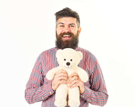 Hipster in fashioned shirt with teddy bear.