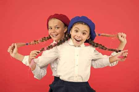 Friendship means support. Kids long braids hairstyle classmates friends.