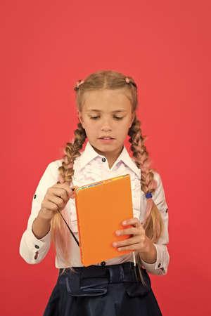 Stationery admirer. Schoolgirl show notepad. School supplies concept. School stationery.