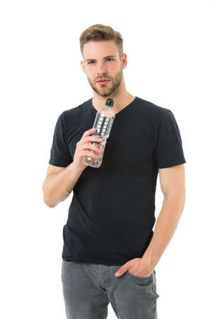 Guy drink water on white background. Man care health and water balance. Sportsman care hydration water nourishment body. Healthy lifestyle concept. Feeling thirsty. Man athlete hold water bottle Banque d'images