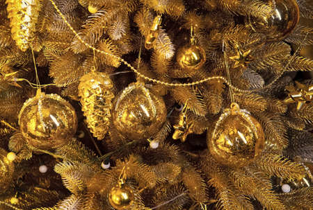 Christmas tree with fir needles on golden background