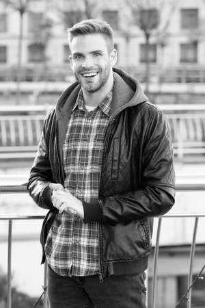 This is what confident man looks like. Happy man on autumn day. Handsome man smile in casual style. Caucasian man on urban outdoor. Casual fashion style. Lifestyle