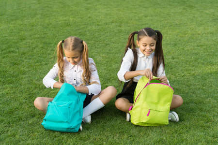 Group study outdoors girls classmates with backpacks, unpacking backpack concept 写真素材