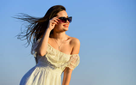 Freedom. Carve out time for yourself. Harmony and balance. Female psychology. Beautiful woman on sunny day blue sky. Female power. Summer fashion. Find inner strength. Girl in sunglasses copy space