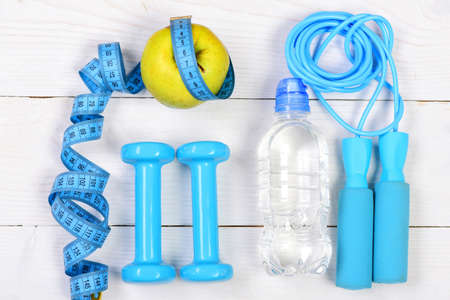 Sports equipment in cyan blue on white background 免版税图像