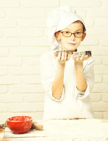 stained cute cook chef boy on brick wall background