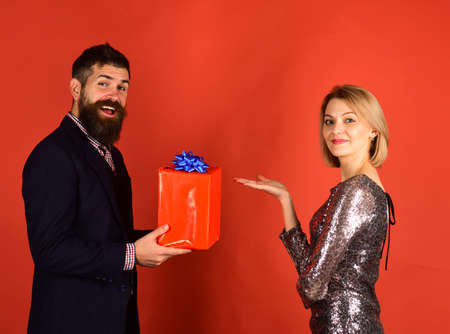 Girl and bearded man with happy faces present gift box.