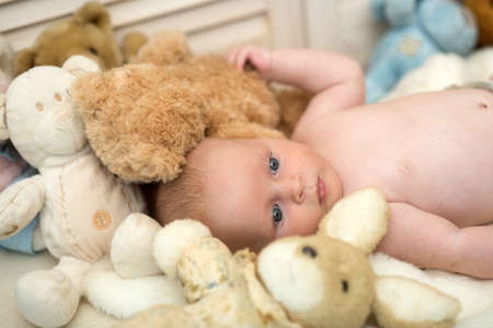 Childhood and curiosity concept. Newborn toddler with blue eyes