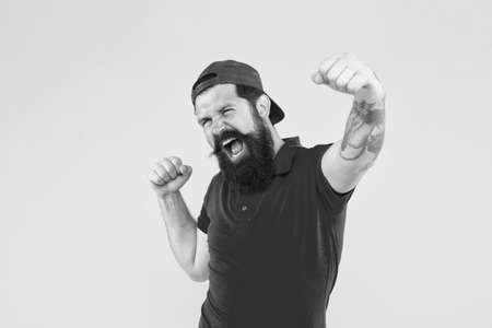 happy emotional guy. male summer fashion. Barber salon and facial hair care. being trendy and brutal. Beard and mustache grooming. happy mature hipster yellow backdrop. bearded man celebrate success
