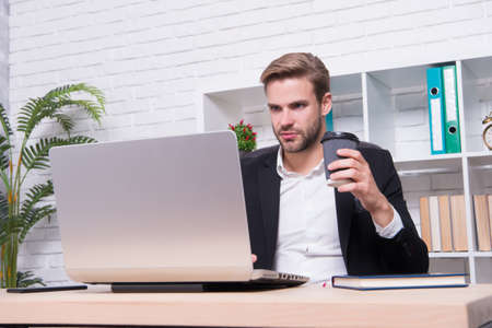 Starting own business. Ceo head office concept. Business development. Businessman drinking coffee. Confident man use laptop. Handsome man in business office. Inspired with cup of fresh coffee